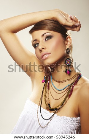 fashion woman with jewelry on light bacground - stock photo