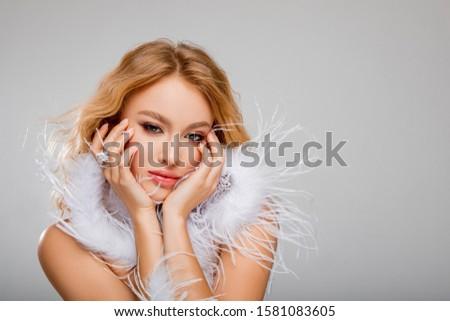 Fashionable winter portrait. Beautiful Portrait Of Young Woman.