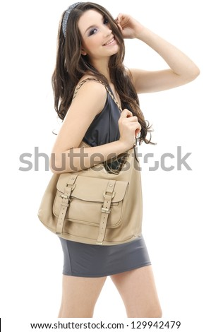 fashionable young woman with handbag posing - stock photo