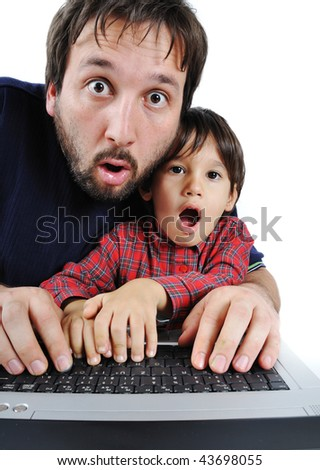 Father and son on laptop, shock