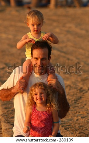 """""""Father with his children on the beach on his shoulders, Hawaii, (Keith Levit)"""""""