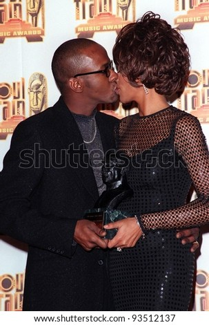 27FEB98:  Singer WHITNEY HOUSTON & husband BOBBY BROWN at the Soul Train Awards where she was presented with the 1998 Quincy Jones Award for Career Achievement.