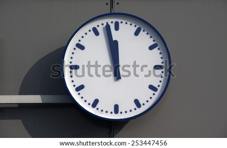 15 february 2015, Amsterdam the Netherlands. Clock at central station Amsterdam pointing two minutes before twelve o clock