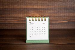 2021 February. Time planning, business, day counting and holidays. Paper calendar on a wooden table