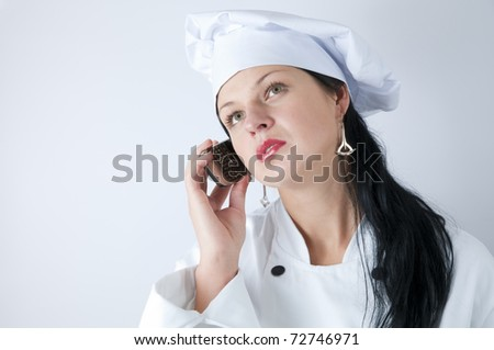 Female Chef Talking On Her Phone - stock photo