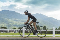 female cyclist cycling on track with road bicycle speed and sprint and sport wellness concept