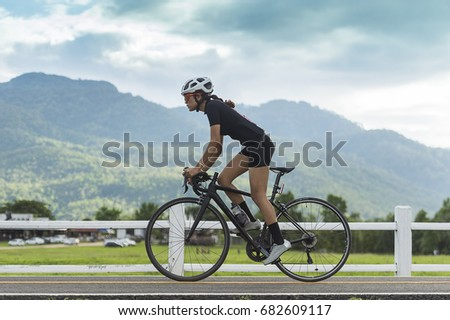 female cyclist cycling on track with road bicycle speed and sprint and sport wellness concept #682609117