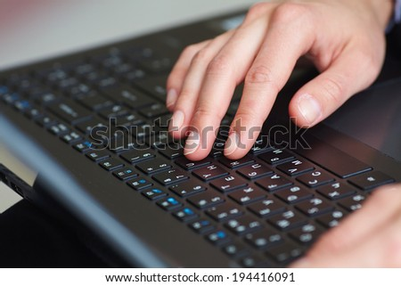 female hands on keyboard - stock photo
