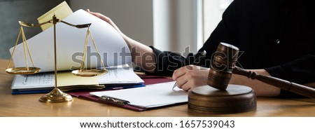 female lawyers working at the law firms. Judge gavel with scales of justice. Legal law, lawyer, advice and justice concept. Foto stock ©