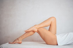Female legs close-up. Spa procedure for legs. Female legs on the background.