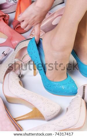 Female legs wearing high heeled shoes
