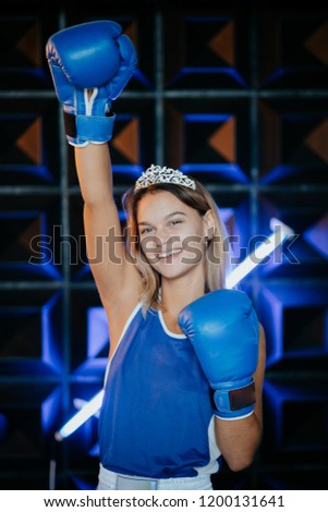 Female rivalry.Woman with gold crown on her head and in a boxing gloves.Sport. Competition.  #1200131641