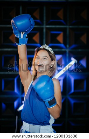 Female rivalry.Woman with gold crown on her head and in a boxing gloves.Sport. Competition. Boxing.  #1200131638