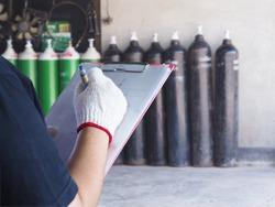 Female technician check Oxygen tank industry