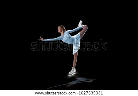 figure skater isolated on black #1027335031