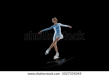 figure skater isolated on black #1027335043