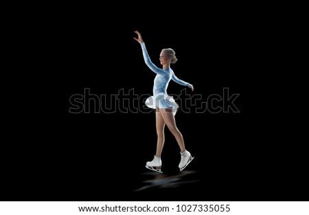 figure skater isolated on black #1027335055