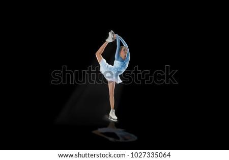 figure skater isolated on black #1027335064