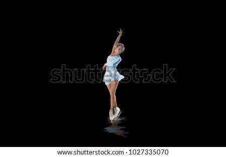 figure skater isolated on black #1027335070