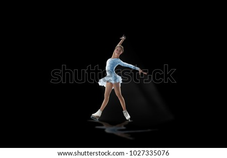 figure skater isolated on black #1027335076