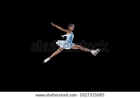 figure skater isolated on black #1027335085