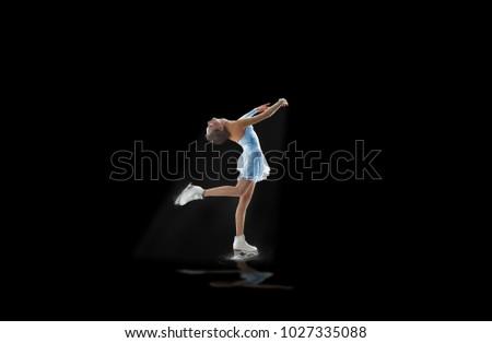figure skater isolated on black #1027335088