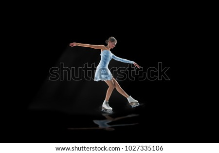 figure skater isolated on black #1027335106