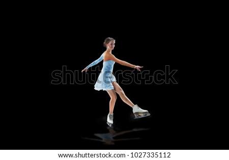 figure skater isolated on black #1027335112