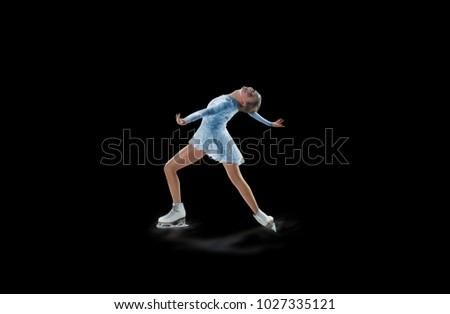 figure skater isolated on black #1027335121