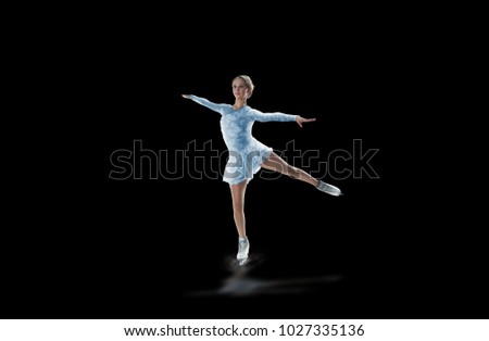 figure skater isolated on black #1027335136