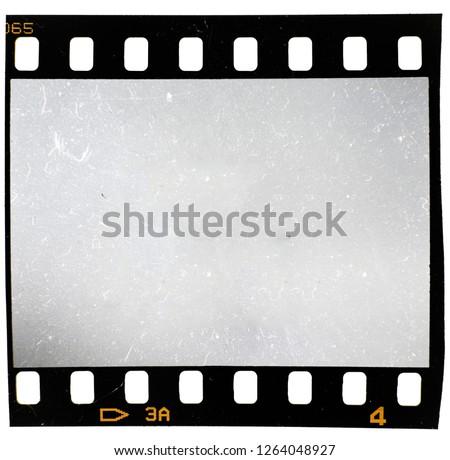 135 film material, 35mm filmstrip on white