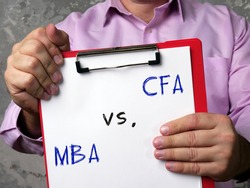 Financial concept about Chartered Financial Analyst CFA vs. MBA Master of Business Administration with phrase on the piece of paper.