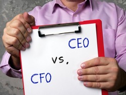 Financial concept about Chief Executive Officer CEO vs. CFO Chief Financial Officer with phrase on the sheet.
