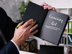 Financial concept about Coaching Gif with phrase on the sheet.