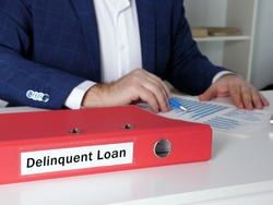 Financial concept about Delinquent Loan with phrase on the document case