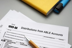 Financial concept about Form 1099-QA Distributions from ABLE Accounts with phrase on the piece of paper.