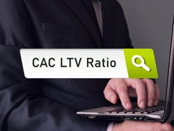 Financial concept meaning Customer Lifetime Value  CAC LTV Ratio Customer Acquisition Cost with sign on the sheet.