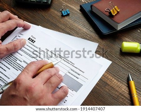 Financial concept meaning Form 8282 Donee Information Return (Sale, Exchange or Other Disposition of Donated Property) with phrase on the piece of paper. Stock photo ©