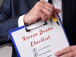 Financial concept meaning Korean Drama Checklist with sign on the sheet.