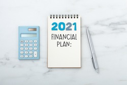 2021 Financial planning text on notebook with calculator and pen