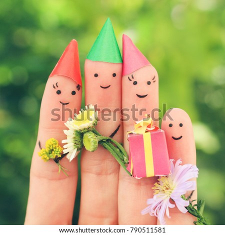 Fingers art of family celebrates birthday. Toned image.
