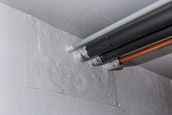 fireproof bulkheads in a wall with tubes