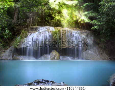 First level of Erawan Waterfall in Kanchanaburi Province, Thailand - stock photo