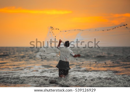 Fisherman throws his net. Arabian Sea.India. #539126929