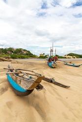 Fishing boats grounded on the sandbar between crocodile lagoon and Elephant Rock near Arugam Bay, Sri Lanka. Circa 2013