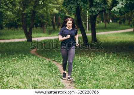 Shutterstock  Fitness girl walks in the park and engaged in various exercises with weights and mat