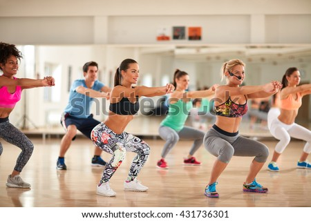 Fitness group doing exercises for shaping breech on fitness class #431736301