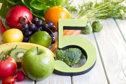 5 Five a day portion size with fresh fruits and vegetables healthy diet lifestyle concept