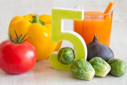 5 Five a day portion with fresh fruits and vegetables healthy diet lifestyle concept