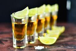 five glasses of alcohol and lime and red chili, a party at the bar, a menu for the bar. Selective focus and copy space, Tequila shots, vodka,whisky, rum